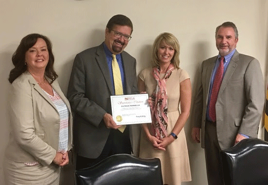L to R: Secretary Kelly M. Schulz, Secretary's Citation Winner Leigh Hoyt, Occupational & Professional Licensing Commissioner Victoria Wilkins, and Deputy Secretary David McGlone