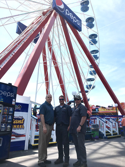 Pictured L to R: Safety Program Manager David Dearborn, Inspector Robbie Finecy and Inspector Pete Yeagy in front of the reassembled Giant Ferris Wheel in Ocean City, Maryland.